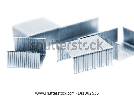 Stack of metal staples. Isolated on a white background.