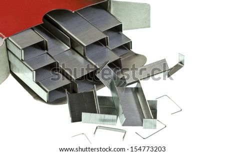 Stack of metal staples isolated on a white background - stock photo