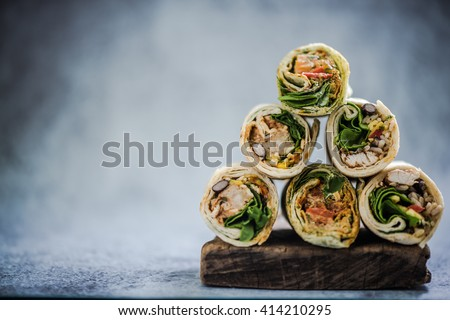 stack of mexican street food fajita wrap, copy space for text