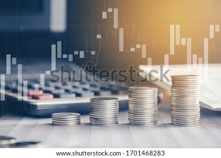 Stack of money coin with trading graph, financial investment concept can be use as background Foto stock ©