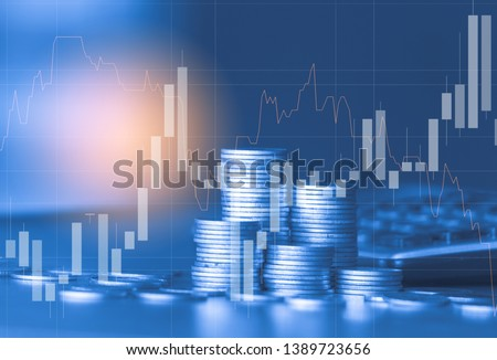 Stack of money coin with trading graph, financial investment concept use for background