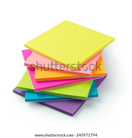 Stack of multicolor sticky note pads on white background