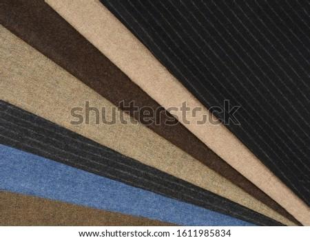 Stack Of Multicolored Fabrics, Tweed Fabrics.