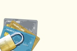 Stack of multiple credit cards with security lock on top isolated with copy space. Concept of credit security over fraud, scam, phishing, theft and other white collar crimes.