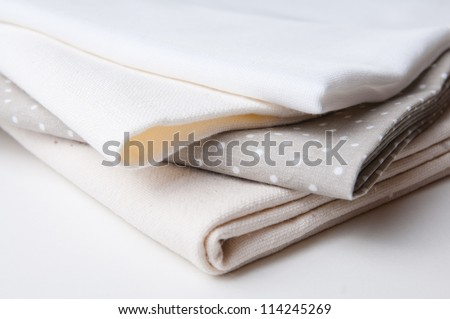stack of new fabrics in different colors and textures, close-up - stock photo
