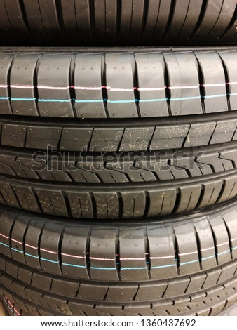 Stack of new tires used by automobiles during summertime. #1360437692