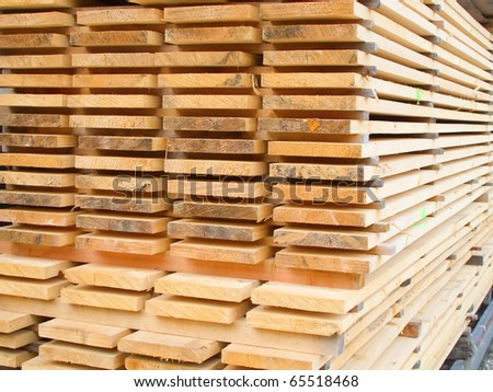 Stack of new wooden studs at a lumber yard