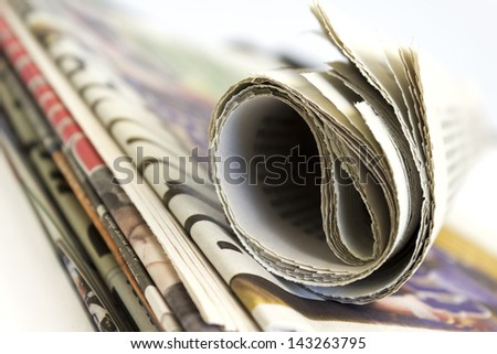 Stack of newspaper shallow depth of field