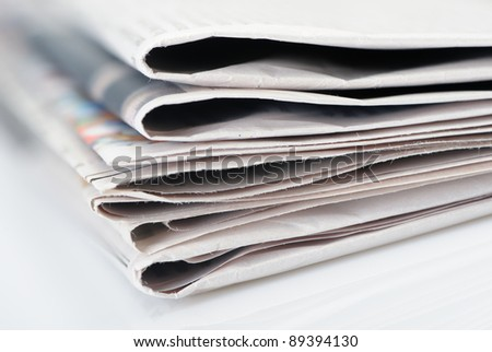 Stack of newspapers. A photo close up. Selective focus