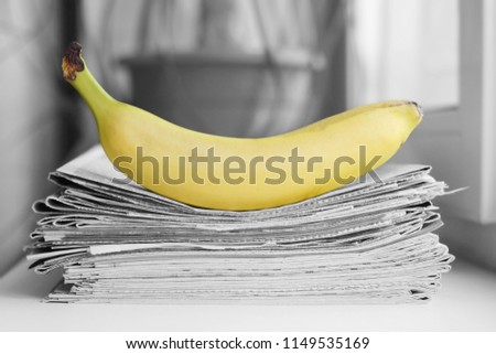 Stack of newspapers and banana. Daily journals with headlines and articles and fresh fruits. Concept for juicy news                                    #1149535169