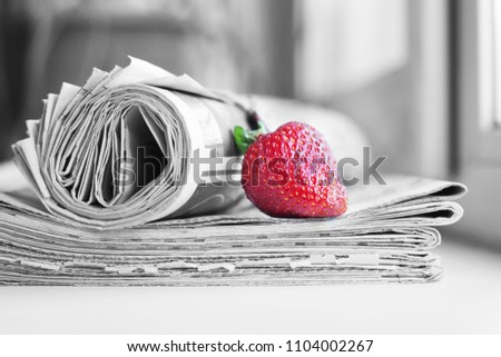Stack of newspapers and strawberries. Daily journals with headlines and articles and fresh fruits. Concept for juicy news                                   #1104002267