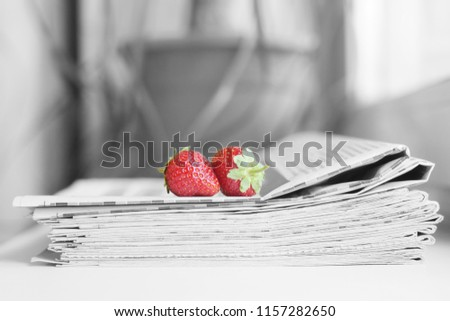 Stack of newspapers and strawberries. Daily journals with headlines and articles and fresh fruits. Concept for juicy news                                                       #1157282650