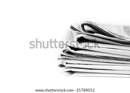 Stack of newspapers in black and white isolated