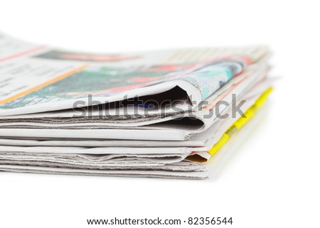 Stack of newspapers isolated on white background