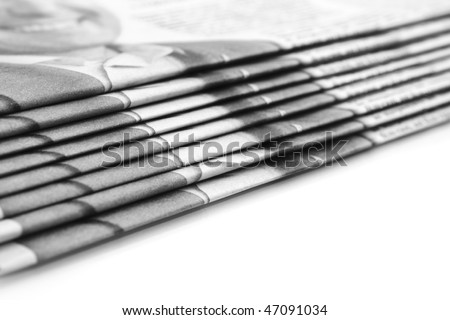Stack of newspapers over white (Shallow DOF)