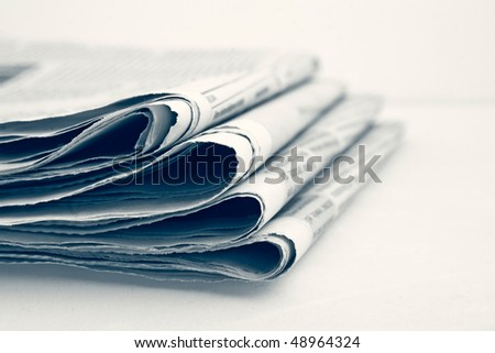 Stack of newspapers. shallow dof