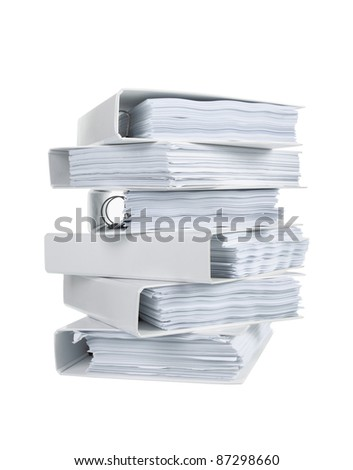 Stack of office ring binders in isolated white