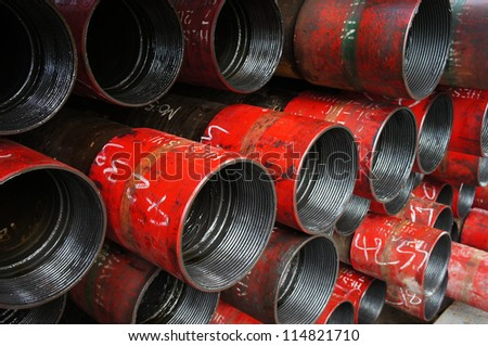 Stack of oil well intemediate casing bundles at box end of casing - stock photo