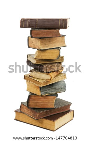 stack of old antique books isolated on white background