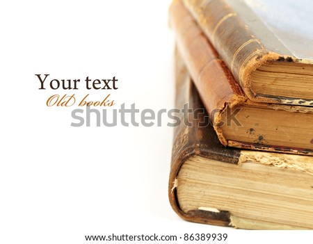 stack of old books on white background