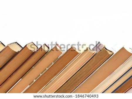 Stack of old books on white background, laid out obliquely Foto stock ©