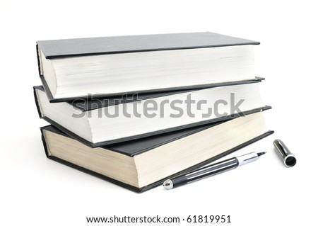 Stack of old books with black covers and a pen isolated on white