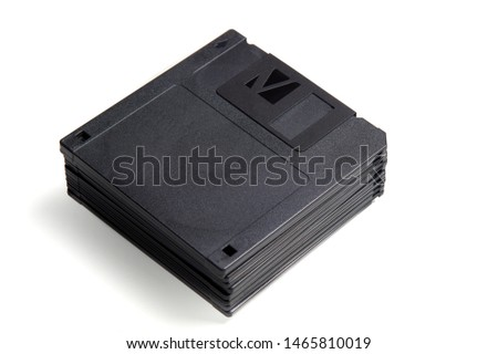 stack of old format floppy disks isolated on white background #1465810019