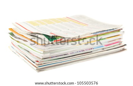 Stack of old magazines isolated on white background