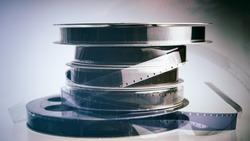 stack of old 16mm bobbins of vintage film. Design element.