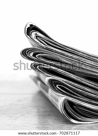 Stack of old newspapers for current events headlines #702871117