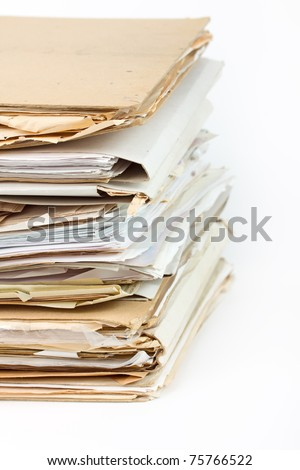 Stack of old paper files isolated on white