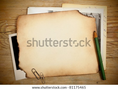 Stack of old papers and photos on a wooden table