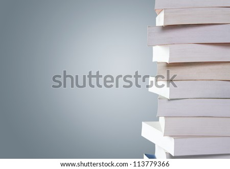Stack of old used books isolated on gray background with copy space