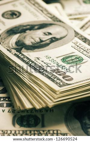 Stack of one hundred dollar bills close-up.