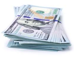 Stack of one hundred dollar bills new design isolated on white background.