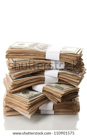 Stack of one hundred dollars banknotes close-up isolated on white