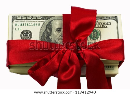 Stack of one hundred dollars banknotes to tie up a red tape close-up isolated on white
