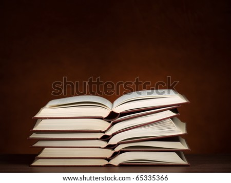 stack of opened books on the desk, for education,literature or studying themes