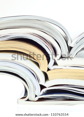 stack of opened magazines isolated on white