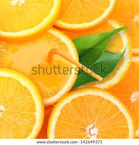 Stack of orange fruit slices with juice background.