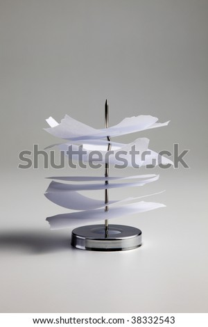 Stack of order checks on paper spindle