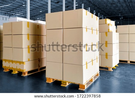 Stack of Package Boxes on Wooden Pallets. Interior of Storage Warehouse. Cardboard Boxes. Cargo Shipment Export-Import. Shipping Warehouse Logistics.