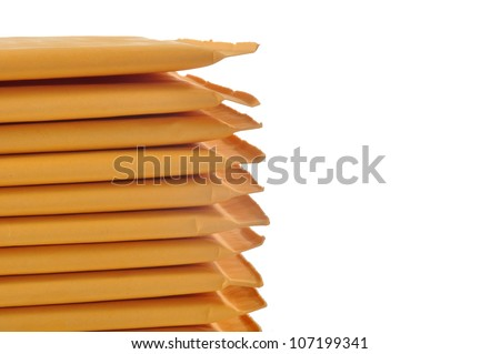 Stack of padded mailing envelopes isolated against a white background - stock photo