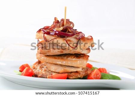 Stack of pan fried pork cutlets