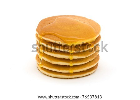 Stack of pancakes isolated on white with syrup