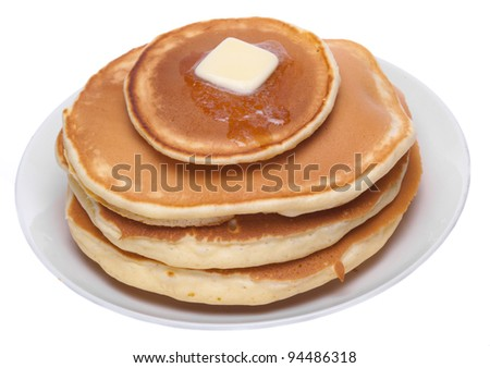 Stack of pancakes on a plate isolated on white