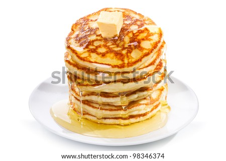 stack of pancakes with butter and syrup on white background