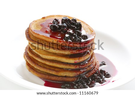 stack of pancakes with jam  on plate
