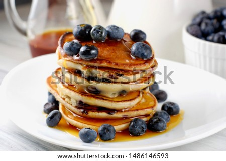 Stack of pancakes with maple syrup and blueberries for breakfast, healthy eating, healthy brunch,