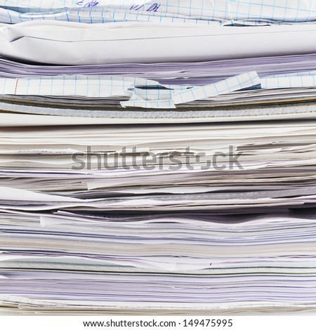 Stack of paper sheets and documents fragment as a business background